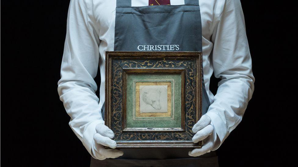 Leonardo Da Vinci's Head of a Bear held by Christie's employee