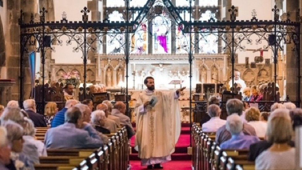 Father Lee Taylor address his congregation