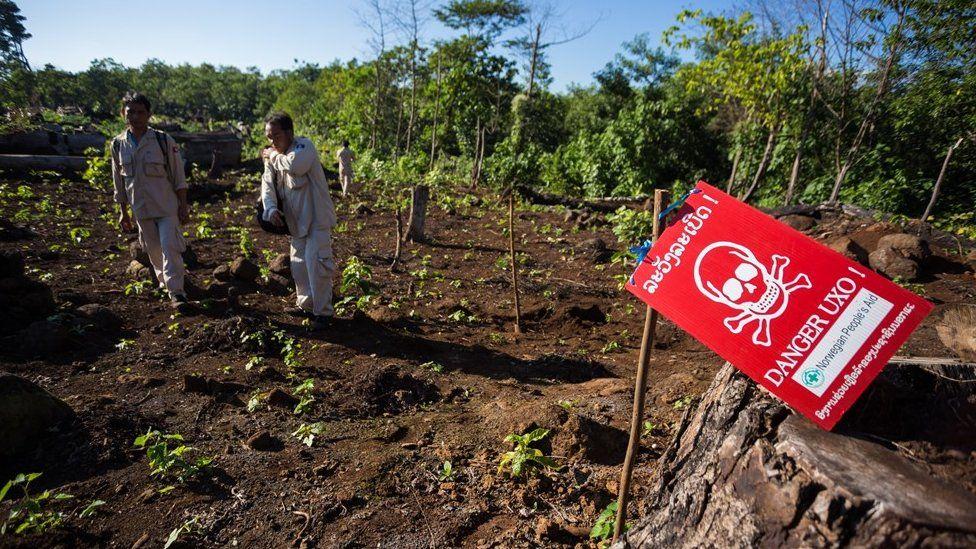 UXO personnel prepare for an ordnance demolition in Laos (December 2014)