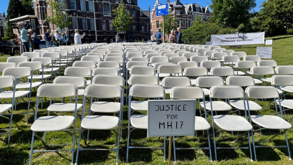 Every year the families of those who died put out 298 empty chairs in sight of the Russian embassy