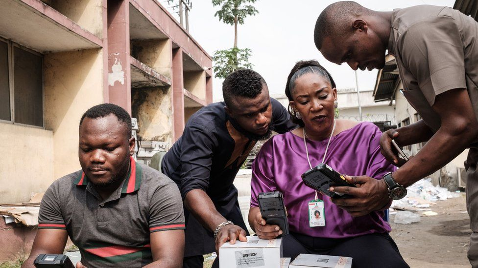 Inec staff begin reconfiguring Smart Card Readers, that were set to work on the previous election day