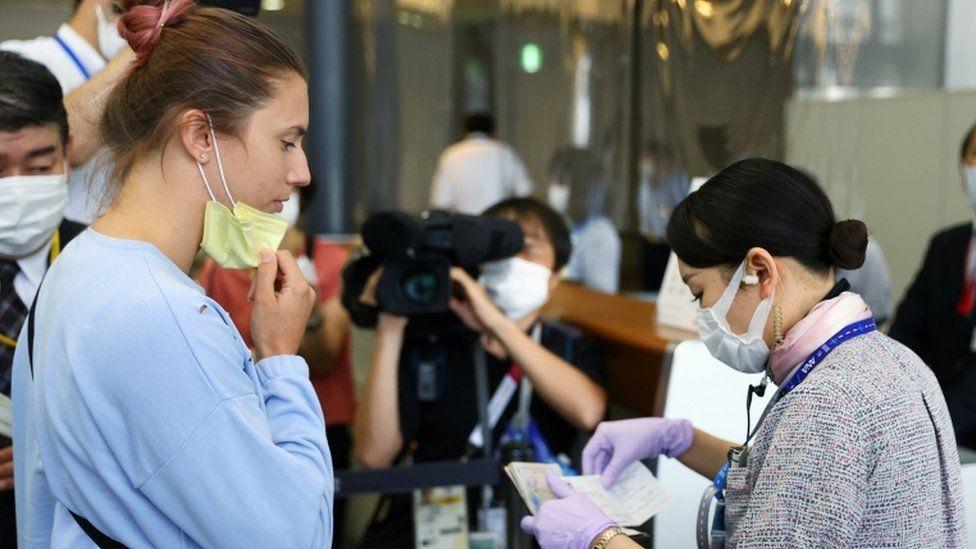 Krystina Timanovskaya has her documents checked at Narita International Airport