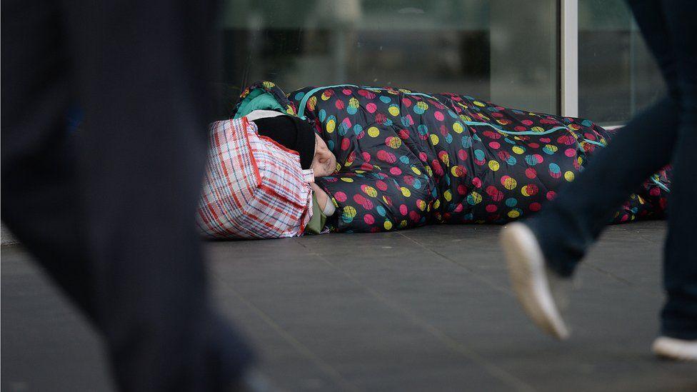 Homeless man on street