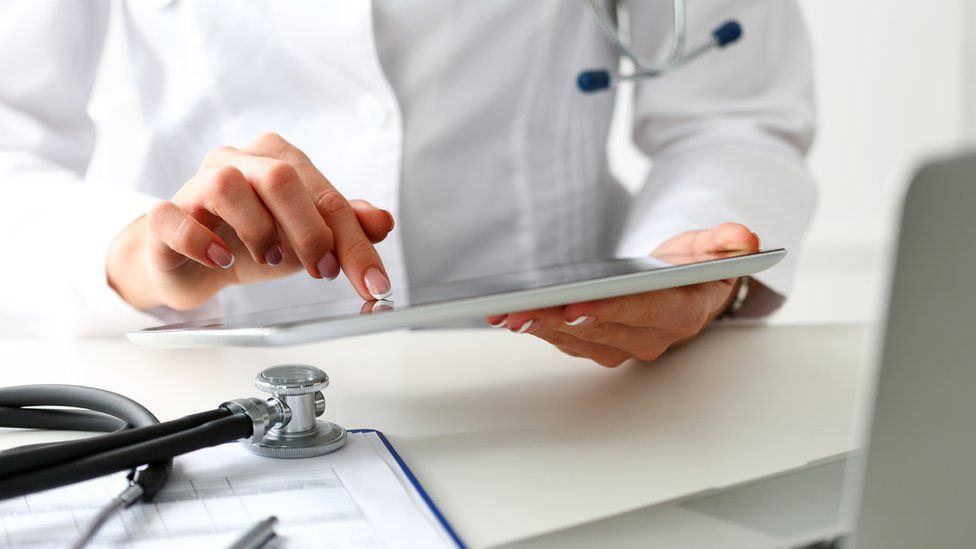 A GP with a tablet computer