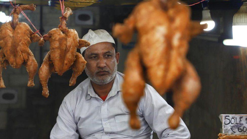 Chicken seller in Delhi market