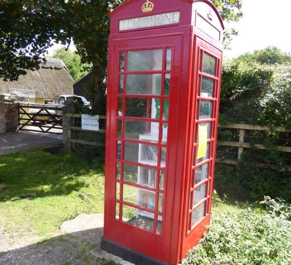 Phone box converted into a book exchange