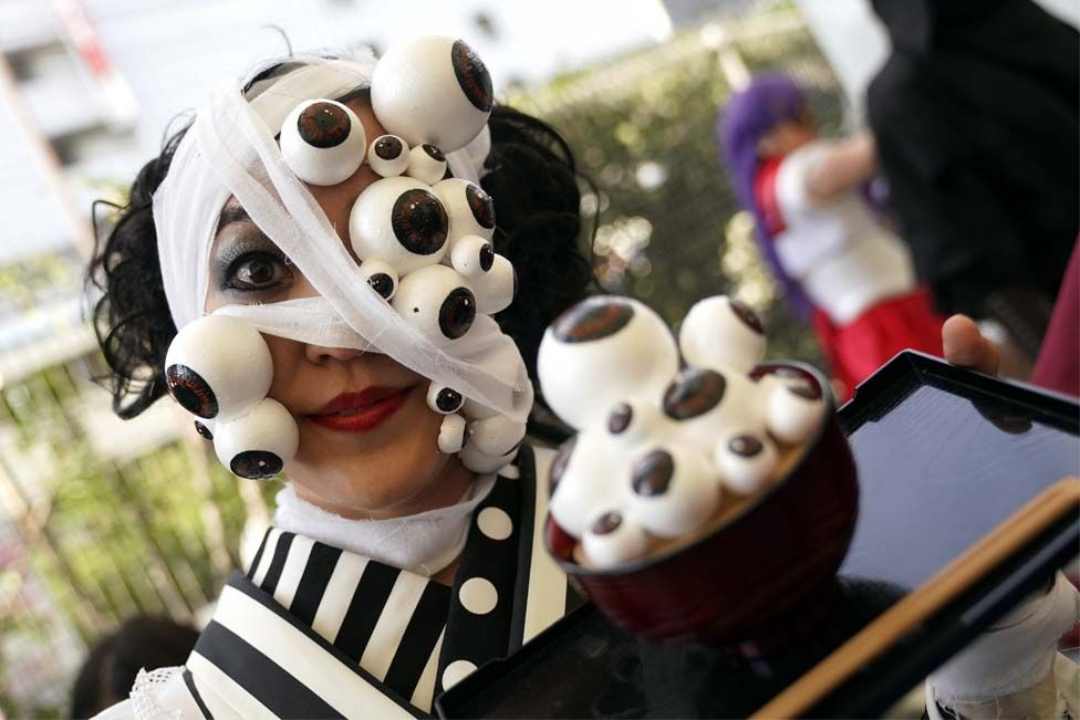 Woman in an eye themed costume