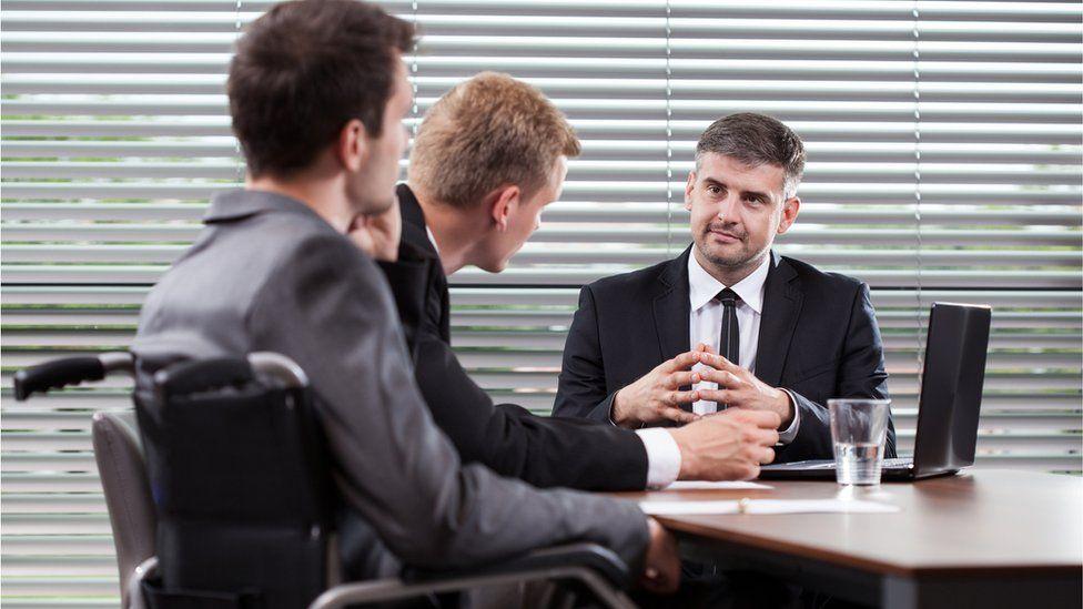 men chatting at work