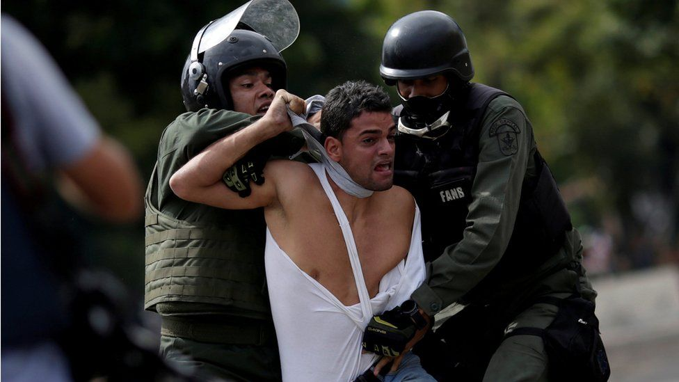 A demonstrator is detained at a rally during a strike called to protest against Venezuelan President Nicolas Maduro's government in Caracas, Venezuela, July 27, 2017