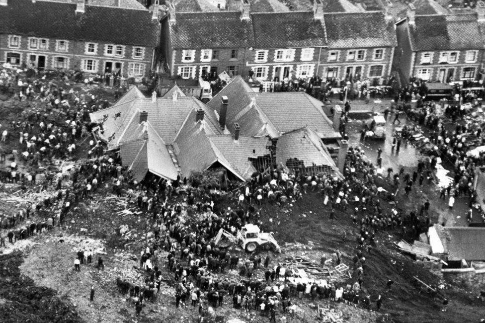 Rescuers digging for trapped children after the slag heap engulfed Pantglas Junior School