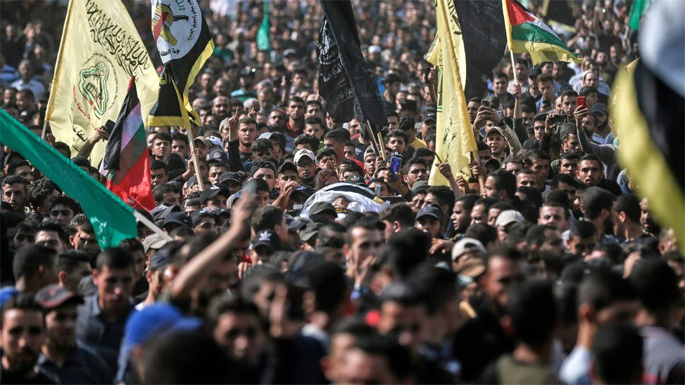 Mourners carry the body of Palestinian Islamic Jihad commander Baha Abu al-Ata at his funeral in Gaza City on 12 November 2019