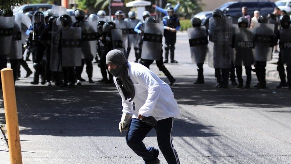 Supporters of the political party Libertad y Refundacion (LIBRE) clash with police, in Tegucigalpa, Honduras, 27 January 2019.