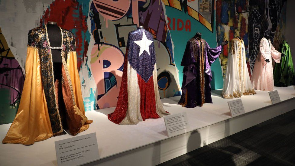 A line of sequinned capes show the star's flamboyant style