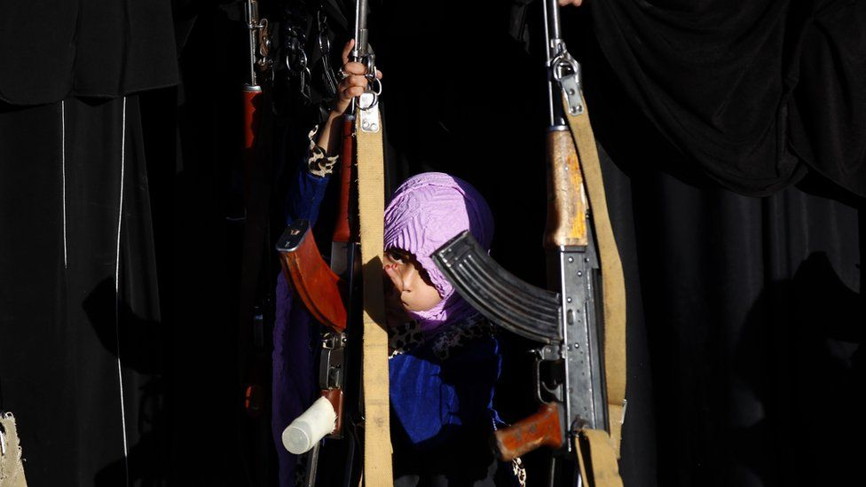 Girl in Sanaa with a rifle