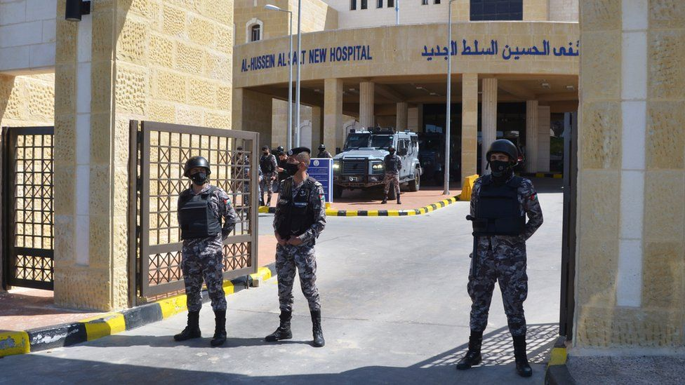 Gendarmerie officers stand guard at the gate of the new Salt government hospital in Jordan, 13 March 2021