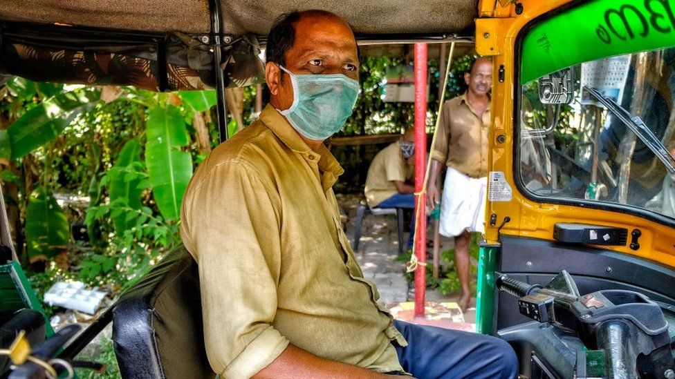 Tuk-tuk driver wearing mask
