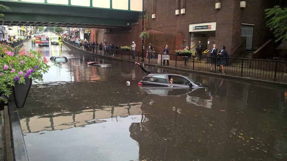 Three cars submerged under water