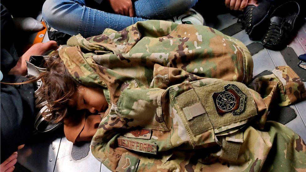 Afghan child in sleeps on the cargo floor of a US Air Force C-17 Globemaster III