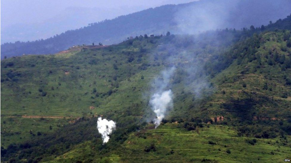 Smoke billows from a mortar shell allegedly fired by the Indian Army from across the Line of Control, at the Nakial sector of Kotli, in Pakistani administered Kashmir, Pakistan, 18 August 2015.