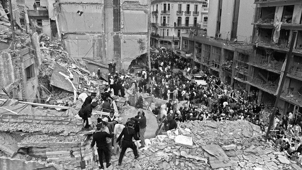 Firemen, policemen and rescuers search the scene of a bomb at the Argentinian Israelite Mutual Association (AMIA) in Buenos Aires, 18 July 1994