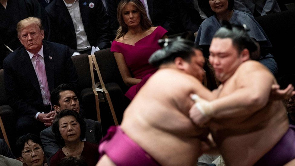 Donald Trump and First Lady Melania Trump watch a sumo battle. 26 May 2019