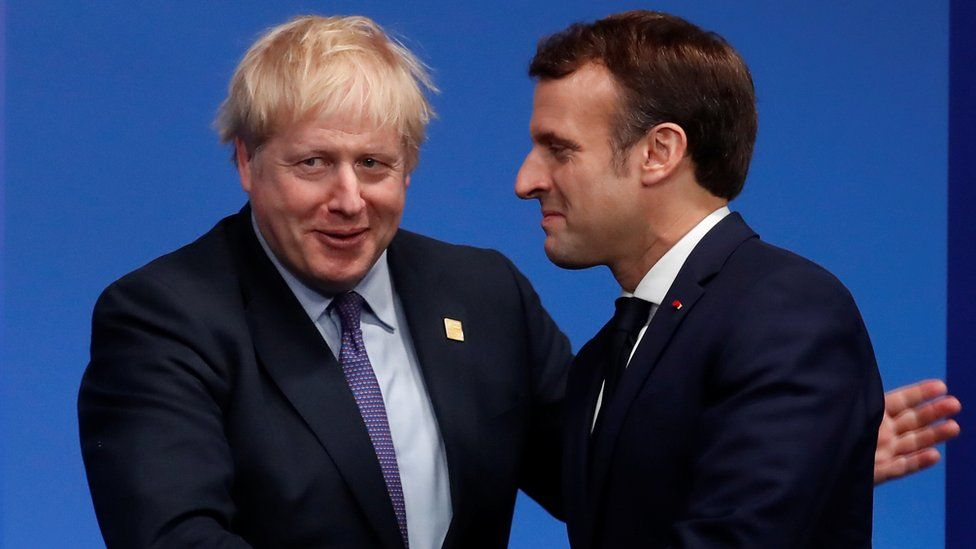 """Britain""""s Prime Minister Boris Johnson welcomes France""""s President Emmanuel Macron at the NATO leaders summit in Watford,"""