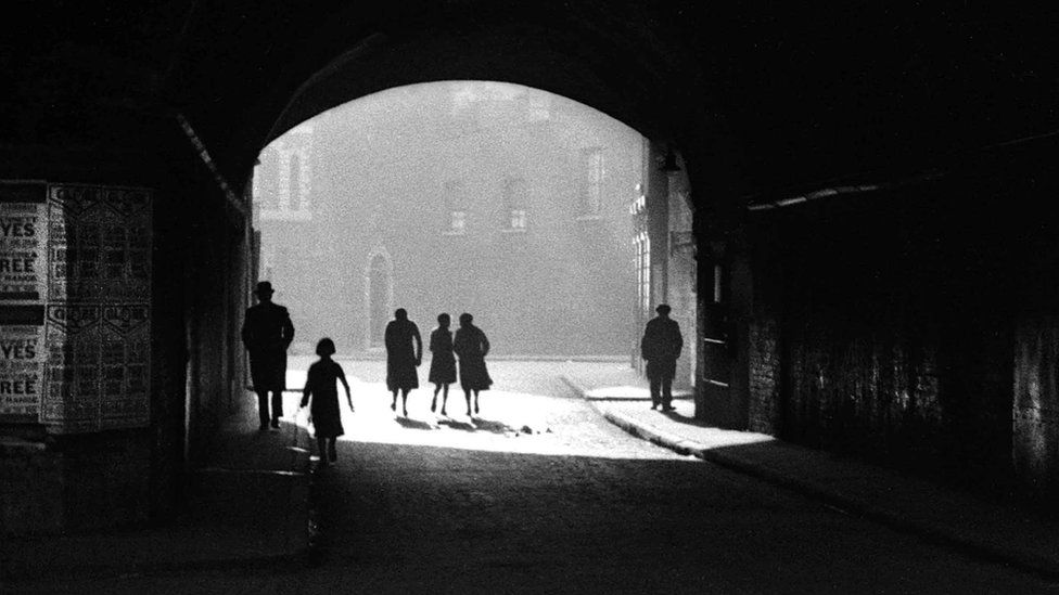Figures in a tunnel, East End of London, 1949