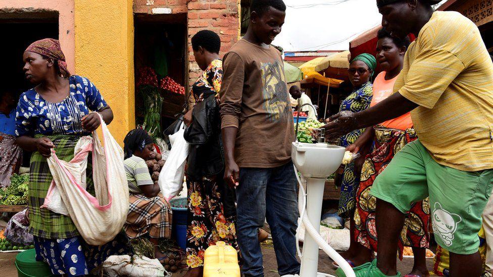 public handwashing station at a bus station in Kigali