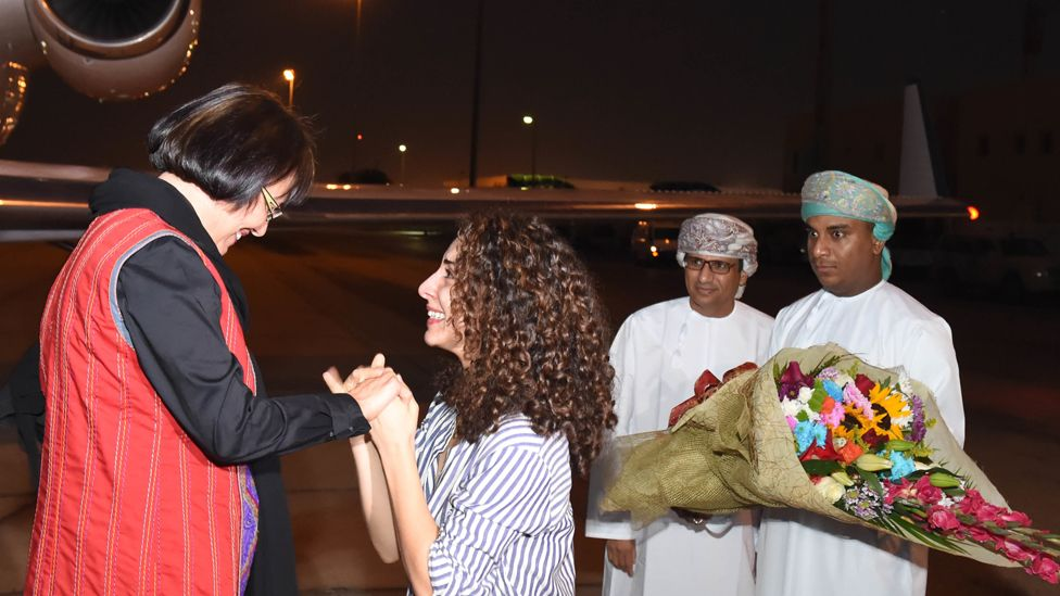 This photo made available by Oman News Agency, shows retired Iranian-Canadian professor Homa Hoodfar arriving in Muscat airport, Oman