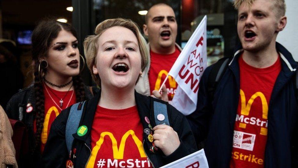 Lauren McCourt protesting outside McDonald's
