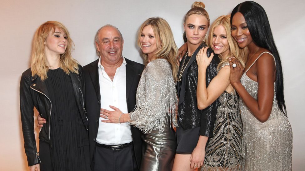 Sir Philip Green, with models/actresses (L-R) Suki Waterhouse, Kate Moss, Cara Delevingne, Sienna Miller and Naomi Campbell in 2014