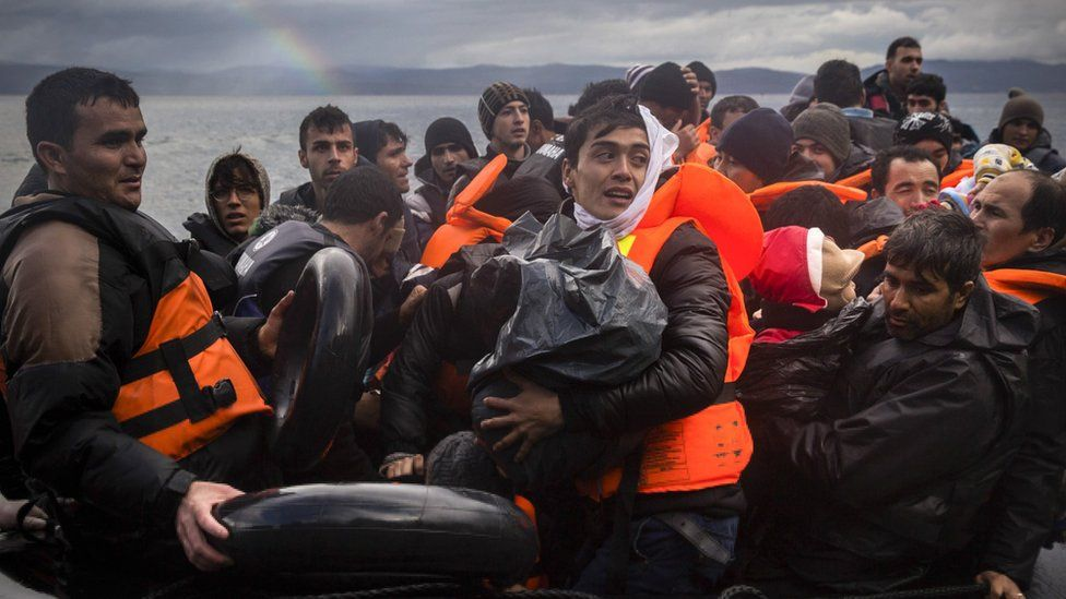 Migrants arrive on the Greek island of Lesbos after crossing from Turkey - 28 November