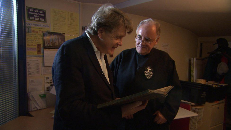 Merlin Holland with Fr Aidan Troy at St Joseph's Church, Paris, during filming for Edward Carson And The Fall Of Oscar Wilde