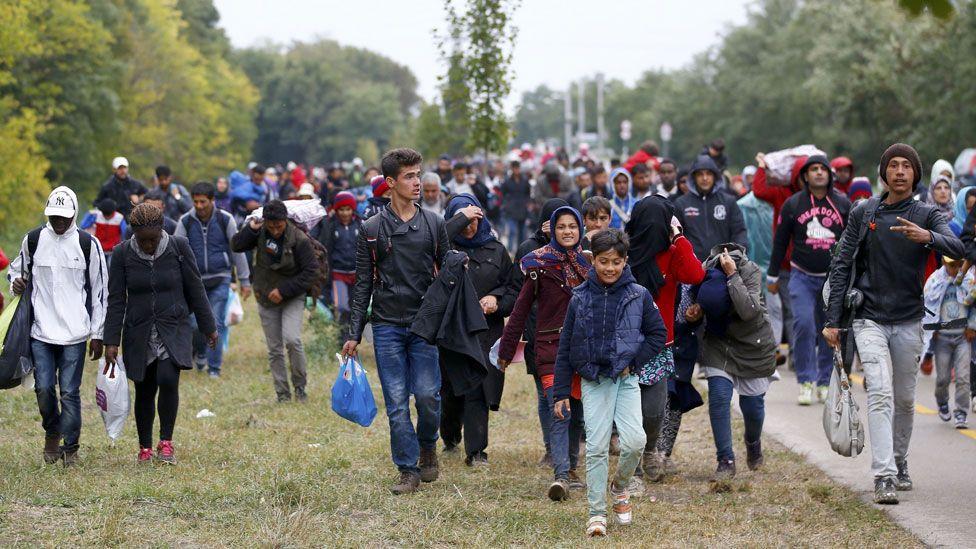 Migrants walk through Hungary