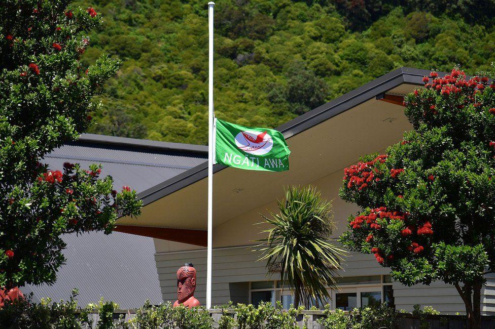 A flag in Whakatane flies at half mast