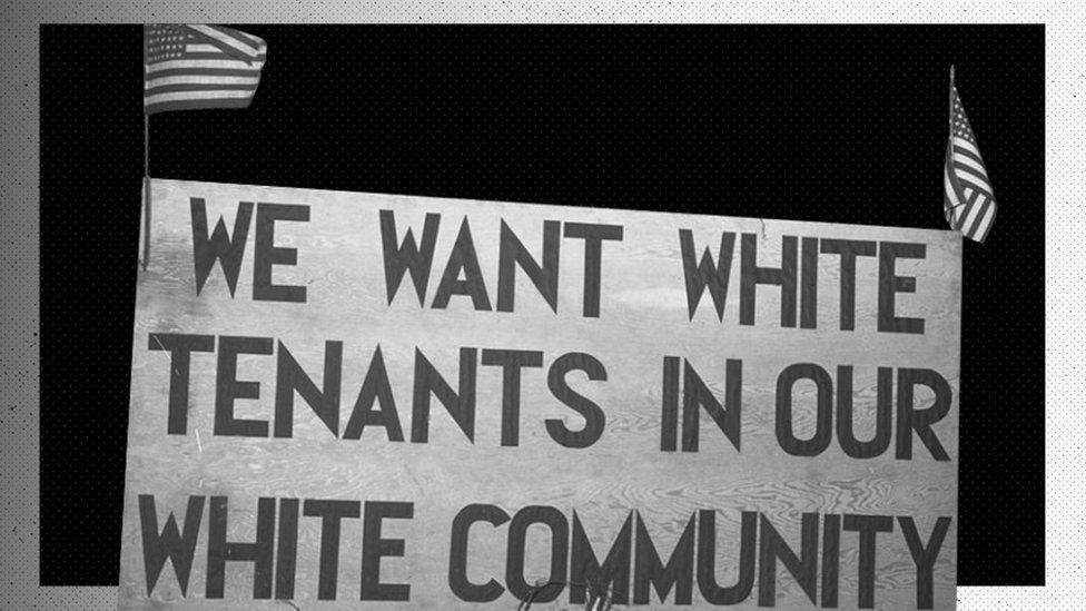 White tenants seeking to prevent African Americans from moving into the Sojourner Truth Homes, a federal governmental housing project, erected this sign. Detroit, Michigan, February 1942