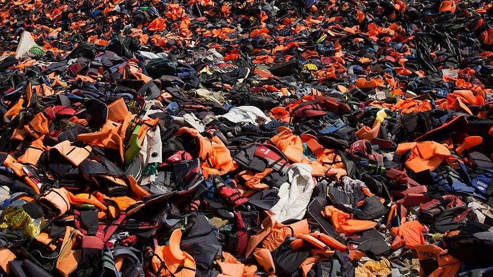 Thousands of discarded life vests in the hills above Mithymna, Greece, in 2016