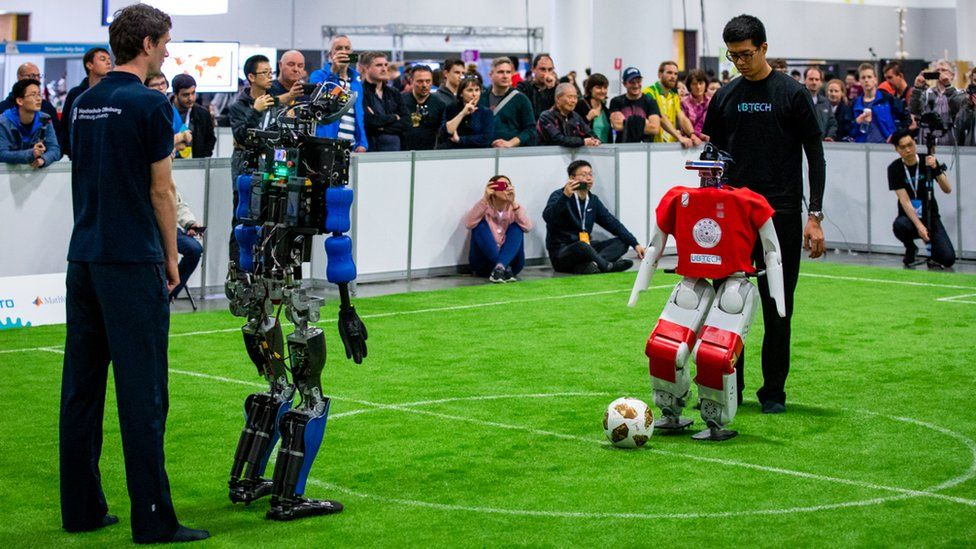 Can football-playing robots beat the World Cup winners by 2050?