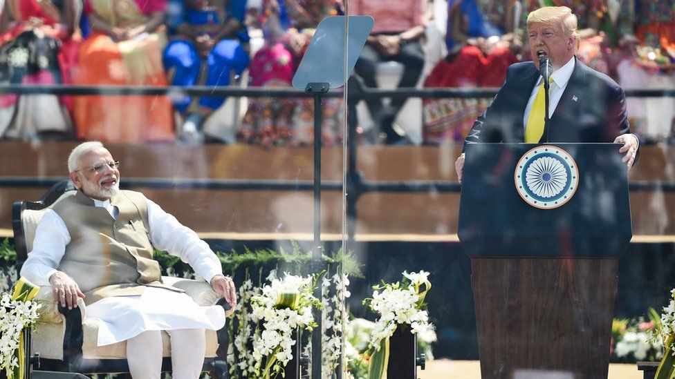 Donald Trump and Narendra Modi on stage during the US president's address