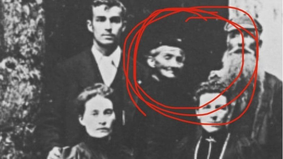 Old photograph of Gwrych Castle staff, with old woman circled