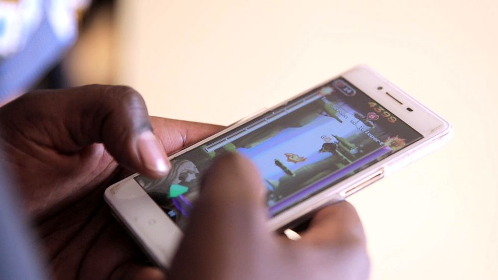 A man playing the Mzito mobile game
