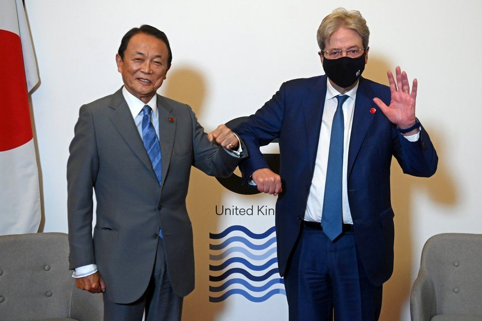 Japan's Finance Minister Taro Aso and European Commissioner for Economy Paolo Gentiloni pose together at a meeting of finance ministers from across the G7 in London, Britain June 4, 2021