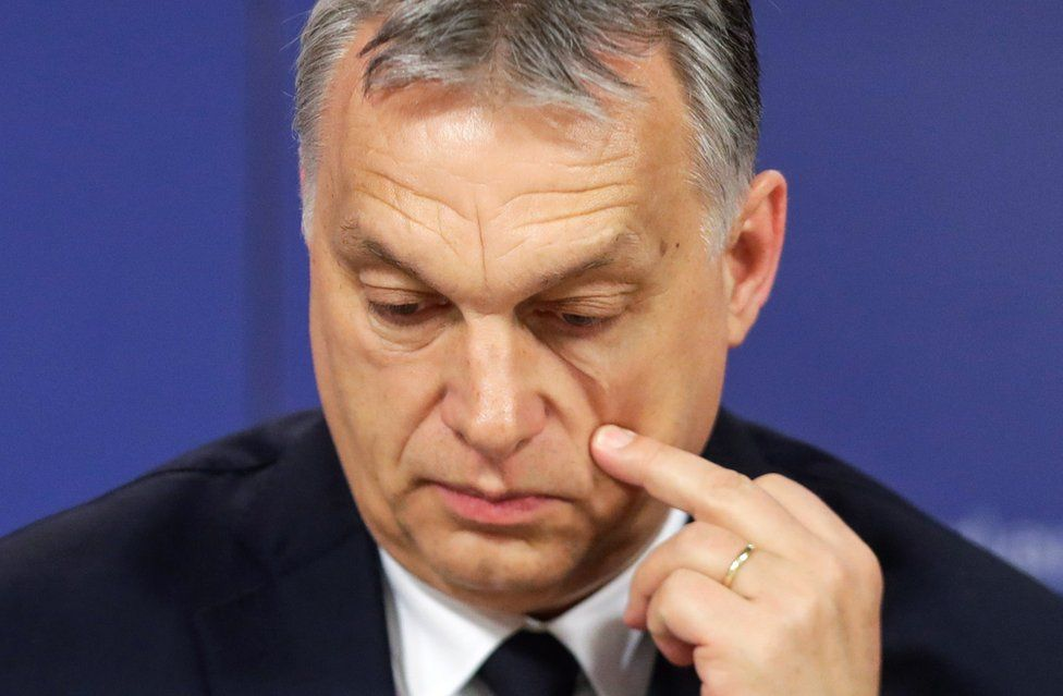 Hungarian Prime Minister Viktor Orban scratches his cheek as he attends a press conference at the end of the European People's Party (EPP) on 20 March