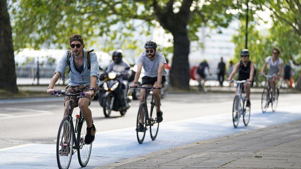 People cycling in Chelsea, London, UK