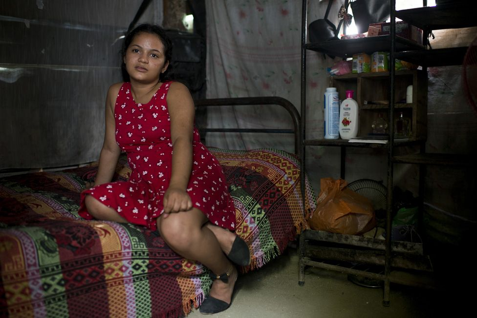 Nahín sits in the one-bedroom shack that is her home