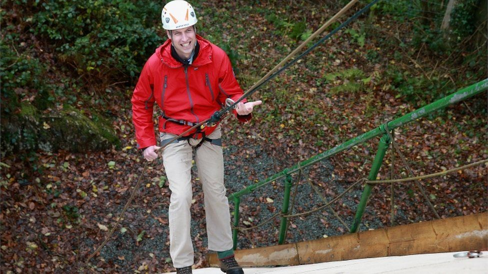 Prince William ascends a climbing wall as he visits the Towers Residential Outdoor Education Centre