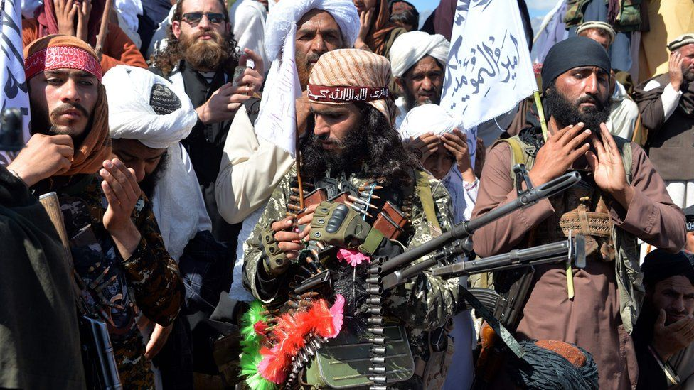 Afghan Taliban militants and villagers attend a gathering as they celebrate the peace deal and their victory in the Afghan conflict on US in Afghanistan, in Alingar district of Laghman Province on March 2, 2020