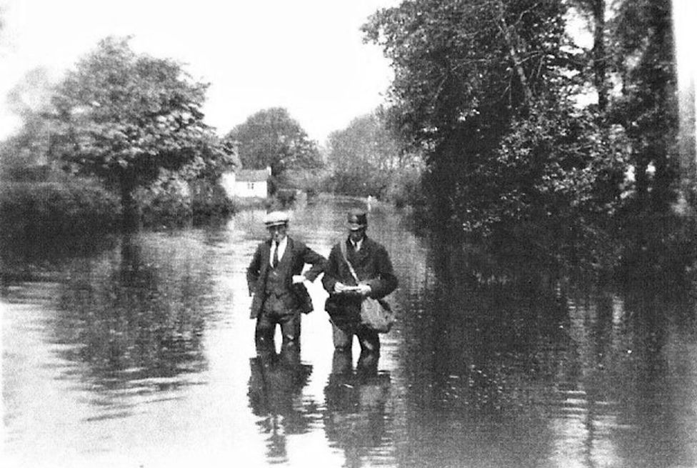 Percy Smith the postman in the flood of 1932, with David Duckitt