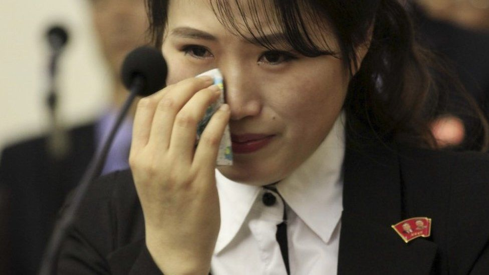 An unidentified colleague of 12 North Korean waitresses who North Korea says was tricked into going to the South wipes her eye as she is presented to the media in Pyongyang, North Korea, Tuesday, May 3, 2016.