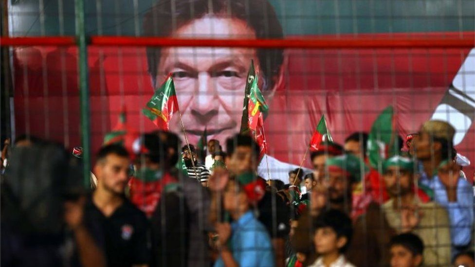 Supporters of Imran Khan, head of Pakistan Tehrik-e-Insaf (PTI) political party listen to his speech, during an election campaign in Karachi, Pakistan, 22 July 2018.